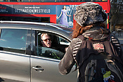 Comedian Jim Davidson remonstrates with a protester, frustrated that he is stuck in traffic as climate change activists from the Extinction Rebellion group block roads in central London at Elephant and Castle in protest that the government is not doing enough to avoid catastrophic climate change and to demand the government take radical action to save the planet, on 21st November 2018 in London, England, United Kingdom. Extinction Rebellion is a climate change group started in 2018 and has gained a huge following of people committed to peaceful protests.