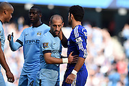 Chelsea's Diego Costa ® with Pablo Zabaleta of Man city of Man city.  Barclays premier league match, Manchester city v Chelsea at the Etihad stadium in Manchester,Lancs on Sunday 21st Sept 2014<br /> pic by Andrew Orchard, Andrew Orchard sports photography.