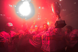 Todd Elik of Acroni Jesenice, Robert Sabolic of Acroni Jesenice and Jesenice's captain Tomo Hafner celebrate with a Trophy  at 6th Round of ice-hockey Slovenian National Championships match between HDD Tilia Olimpija and HK Acroni Jesenice, on April 2, 2010, Hala Tivoli, Ljubljana, Slovenia.  Acroni Jesenice won 3:2 after overtime and became Slovenian National Champion 2010. (Photo by Vid Ponikvar / Sportida)