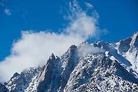 Clouds clear from mountain ridge, Sierra Nevada Mountains, California