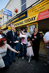 UK ENGLAND LONDON 19AUG11 - Re-opening ceremony of Siva Kandiah's convenience store in Clarence Road, Hackney, east London. Local shopkeeper Siva Kandiah ran the Clarence Convenience Store for 11 years - and had to watch as it was ransacked and destroyed, leaving him with no stock, no money in the till, and no store. During the August riots in London, Clarence Road in Hackney featured some of the most devastating scenes of looting and violence...jre/Photo by Jiri Rezac..© Jiri Rezac 2011