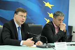 June 15, 2018 - Athens, Greece - Greek Finance Minister Euclid Tsakalotos (R) listens to European Commission Vice President Valdis Dombrovskis (L) during their joint media conference following a meeting at the Greek Finance Ministry, in Athens. Tsakalotos earlier the same day met already with Managing Director of the European Stability Mechanism (ESM) Klaus Regling to discuss the ESM's financial assistance to euro area countries experiencing or threatened by severe financing problems. (Credit Image: © Aristidis Vafeiadakis via ZUMA Wire)