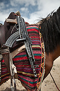 On a horse, the Kalashnikov of a guard of the Aghanistan Border Police patrolling the borders between Tajikistan and China...Trekking through the high altitude plateau of the Little Pamir mountains (average 4200 meters) , where the Afghan Kyrgyz community live all year, on the borders of China, Tajikistan and Pakistan.