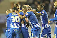 Wigan players celebrate injury time winner during the Sky Bet League 1 match between Wigan Athletic and Gillingham at the DW Stadium, Wigan, England on 7 January 2016. Photo by Mark P Doherty.