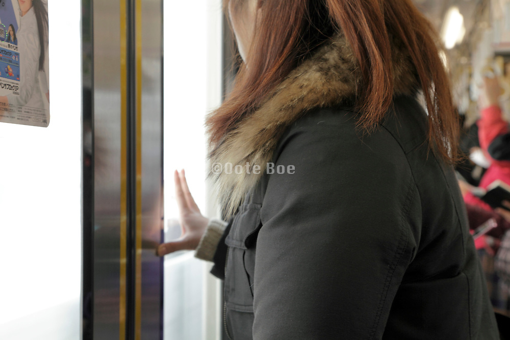 female person looking out the window while traveling on a train