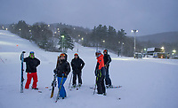 A group of skiers after a run down Smith Trail in the fresh snow on Tuesday evening at Gunstock Mountain.   (Karen Bobotas/for the Laconia Daily Sun)