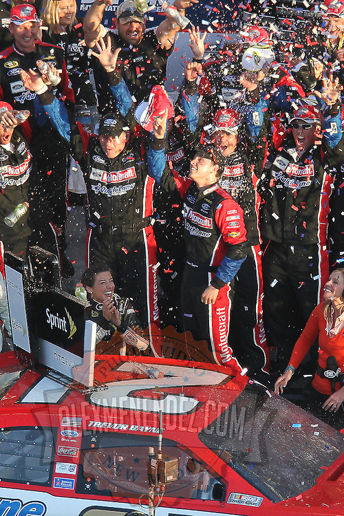 Trevor Bayne celebrates in Victory Lane after winning the Daytona 500 Sprint Cup race at Daytona International Speedway on February 20, 2011 in Daytona Beach, Florida. (AP Photo/Alex Menendez)