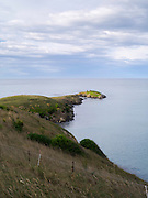 Katiki Point stretches into the Pacific Ocean; Katiki Point, near Moeraki, Otago, New Zealand.