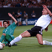 Germany's Carsten Janker slides in on Saudi Arabia's Hussain Sulimani but his goal was dissallowed
