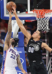 November 14, 2018 - Orlando, FL, USA - The Orlando Magic's Aaron Gordon (00) blocks a shot by the Philadelphia 76ers' Wilson Chandler (22) at the Amway Center in Orlando, Fla., on Wednesday, Nov. 14, 2018. (Credit Image: © Stephen M. Dowell/Orlando Sentinel/TNS via ZUMA Wire)