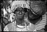 Without craziness, one does not live. Tanzanian proverb.<br /> <br /> A Jola entertainer. For the Jola people of southern Senegal entertaining and dancing are an integral part of their culture. The Gambia  1994