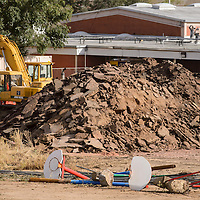 Uprooted basketball hoops lay on the edge of a construction site at Washington Elementary School in Gallup Friday.