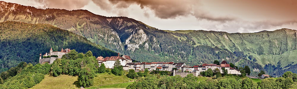 View of the famous village of Gruyeres (origine of the Gruyeres cheese) in the Freiburg county, Switzerland