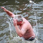 NLD/Amsterdam/20110806 - Canalpride Gaypride 2011, mensen springen in het water