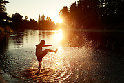 A child plays in the Snoqualmie River near Fall City. (Erika Schultz / The Seattle Times)
