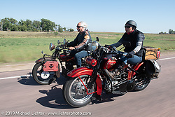 Land-speed record holder Jody Perewitz riding a 1926 Harley-Davidson JD beside Doug Feinsod on his Indian on the Motorcycle Cannonball coast to coast vintage run. Stage 8 (314 miles) from Spirit Lake, IA to Pierre, SD. Saturday September 15, 2018. Photography ©2018 Michael Lichter.