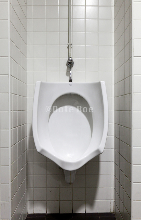 clean white urinal in a public toilet