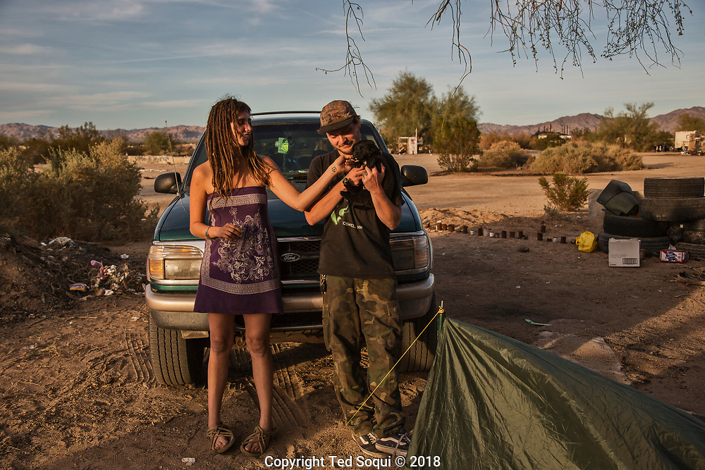 Angie and her friend Dylan at their campsite. They drove down from Canada to visit Slab City.<br /> Slab City and the local environs.