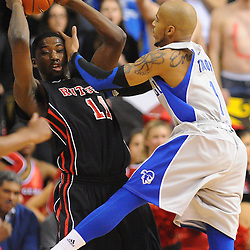 Seton Hall Pirates guard Jordan Theodore (1) fouls Rutgers Scarlet Knights guard/forward Dane Miller (11) during second half Big East NCAA Basketball between the Rutgers Scarlet Knights and Seton Hall Pirates at the Louis Brown Athletic Center. Seton Hall defeated Rutgers 59-55.