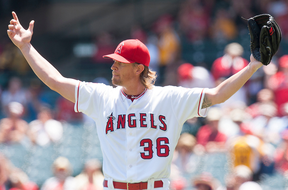 The Angels' Jered Weaver celebrates after Gregorio Petit made a nice catch to start a double play to end the top the first inning against the Chicago White Sox at Angel Stadium on Sunday.<br /> <br /> ///ADDITIONAL INFO:   <br /> <br /> angels.0718.kjs  ---  Photo by KEVIN SULLIVAN / Orange County Register  -- 7/17/16<br /> <br /> The Los Angeles Angels take on the Chicago White Sox at Angel Stadium.
