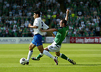Photo: Andrew Unwin.<br />Northern Ireland v Azerbaijan. FIFA World Cup Qualifying match. 03/09/2005.<br />Northern Ireland's Stuart Elliott (R) looks to tackle Azerbaijan's Aslan Kerimov (L).