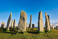 Calanais Standing Stones  central stone circle erected between 2900-2600BC measuring 11 metres wide. At the centre of the ring stands a huge monolith stone 4.8 metres high weighing about 7 tonnes, which is perfectly orientated so that its widest sides face due north south. Calanais Neolithic Standing Stone (Tursachan Chalanais) , Isle of Lewis, Outer Hebrides, Scotland. .<br /> <br /> Visit our SCOTLAND HISTORIC PLACXES PHOTO COLLECTIONS for more photos to download or buy as wall art prints https://funkystock.photoshelter.com/gallery-collection/Images-of-Scotland-Scotish-Historic-Places-Pictures-Photos/C0000eJg00xiv_iQ<br /> '<br /> Visit our PREHISTORIC PLACES PHOTO COLLECTIONS for more  photos to download or buy as prints https://funkystock.photoshelter.com/gallery-collection/Prehistoric-Neolithic-Sites-Art-Artefacts-Pictures-Photos/C0000tfxw63zrUT4