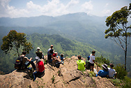 Visitors to Sri Lanka enjoy the the mountainous landscape viewed from Ella Rock, a popular viewpoint on the outskirts of Ella, Sri lanka.