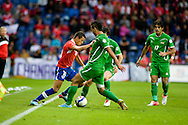 14.09.13. Brondby, Denmark.Alexis Sanchez of Chile is challenged by two players during friendly match at the Brondby Stadium in Denmark.Photo: © Ricardo Ramirez