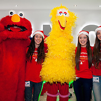 Santa's Helpers Sarah Talty, Eimar Carroll and Emma Talty with Elmo and Big Bird at Shannon Airport