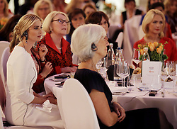 April 25, 2017 - Berlin, GERMANY - Ivanka Trump, daughter and adviser of U.S. President Donald Trump, left, listens to a speech of German Chancellor Angela Merkel during a dinner after she participated in the W20 Summit in Berlin Tuesday, April 25, 2017. (Credit Image: © Prensa Internacional via ZUMA Wire)