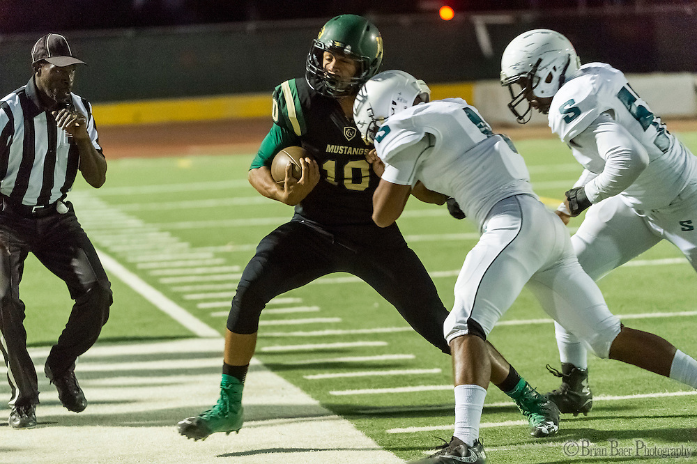 Monterey Trail Mustangs Robert Holt (10), is pushed out of bounds during the first quarter as the Monterey Trail Mustangs host the Sheldon High School Huskies Friday Sep 23, 2016.<br /> photo by Brian Baer