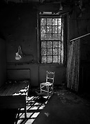 Solitary chair by a window