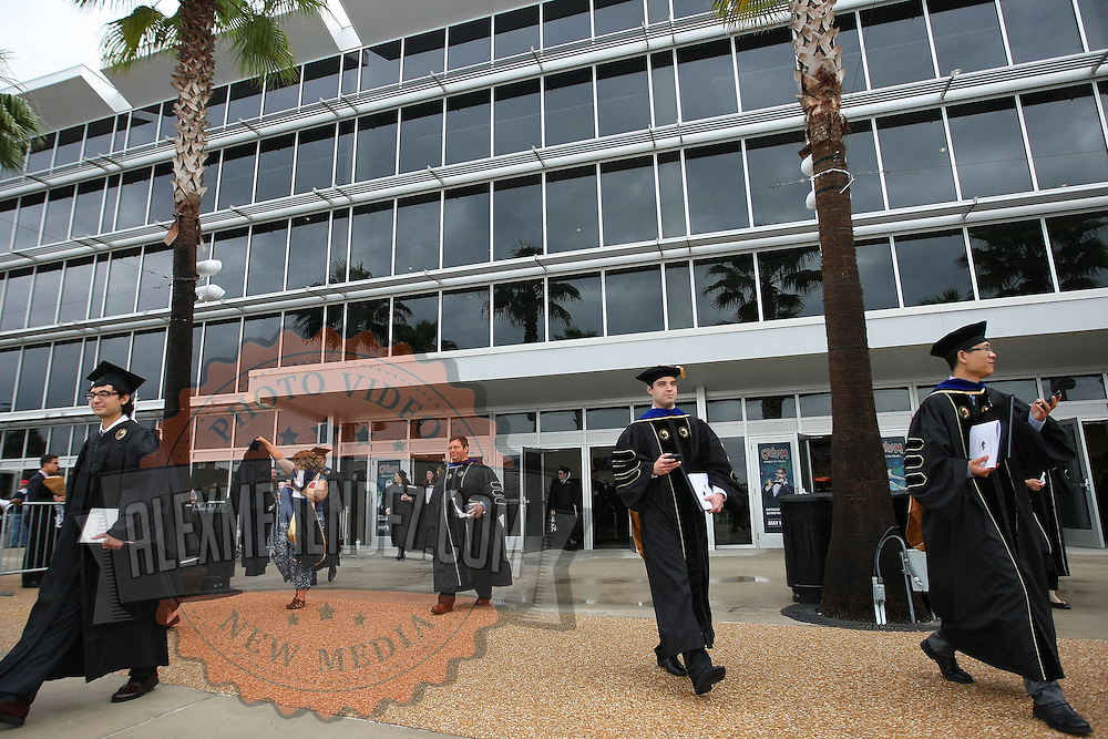 Graduates exit after their ceremony for UCF's College of Health and Public Affairs and the College of Medicine's Burnett School of Biomedical Sciences at the UCF Arena on Thursday, May 2, 2013 in Orlando, Florida.  (AP Photo/Alex Menendez)