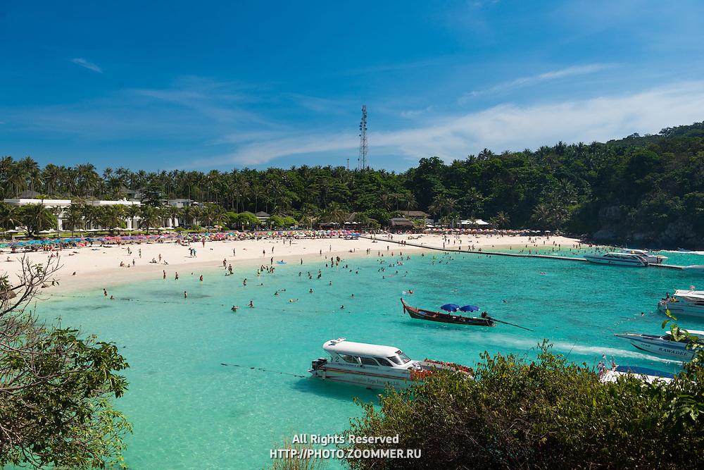 Tourists on the main beach of Raya island, Thailand