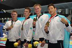 August 24, 2018 - Jakarta, Indonesia - Athletes of Kazakhstan pose for pictures after the awarding ceremony of men's 4x100m medley relay final of swimming at the 18th Asian Games in Jakarta, Indonesia, Aug. 24, 2018. Kazakhstan won the bronze medal. (Credit Image: © Fei Maohua/Xinhua via ZUMA Wire)