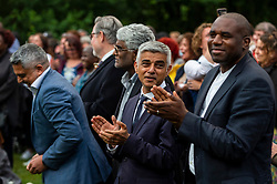 © Licensed to London News Pictures. 03/08/2021. LONDON, UK.  Sadiq Khan, Mayor of London, (C), and David Lammy, MP for Tottenham, (R), at a vigil at Barn Hill Pond, Fryent Country Park near Wembley to remember the lives of sisters Bibaa Henry and Nicole Smallman, on what would have been Nicole's 29th birthday.  The sisters were murdered in the park in June 2020 whilst celebrating Bibbaa's birthday.  Reclaim These Streets have worked with former Archdeacon of Southend, the Ven. Wilhelmina (Mina) Smallman, the late sisters' mother, to organise the vigil and attendees were encouraged to wear green and purple, the sisters' favourite colours, or light a candle.  Photo credit: Stephen Chung/LNP