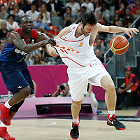 02 August 2012: Spain Fernando San Emeterio is fouled by Luol Deng during 79-78 Team Spain victory over Team Great Britain, during the men's basketball preliminary, at the Basketball Arena, in London, Great Britain.