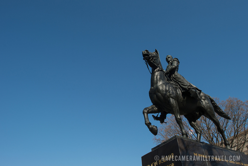 Front right view of a large statue of Venezuelan leader Simon Bolivar, by Felix de Weldon, that stands in a park in front of the Interior Department in Foggy Bottom in northwest Washington DC. The statue was installed as a gift of the Venezuelan Government in 1955 and is formally titled Equestrian of Simon Bolivar.