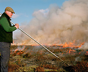 Gamekeeper Bruce Watson heather burning on the Moors in Nidderdale AONB, North Yorkshire, UK. Heather is burnt to regenerate it, the more patches there are on the moor the better it is, producing more habitat for the grouse, and that has a knock on effect for the wader population as well.