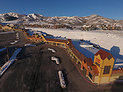 SHOT 3/2/17 7:46:38 AM - Aerial photos of Park City, Utah. Park City lies east of Salt Lake City in the western state of Utah. Framed by the craggy Wasatch Range, it's bordered by the Deer Valley Resort and the huge Park City Mountain Resort, both known for their ski slopes. Utah Olympic Park, to the north, hosted the 2002 Winter Olympics and is now predominantly a training facility. In town, Main Street is lined with buildings built primarily during a 19th-century silver mining boom that have become numerous restaurants, bars and shops. (Photo by Marc Piscotty / © 2017)