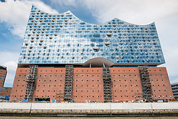 View of new Elbphilharmonie concert hall nearing completion on River Elbe in Hamburg Germany