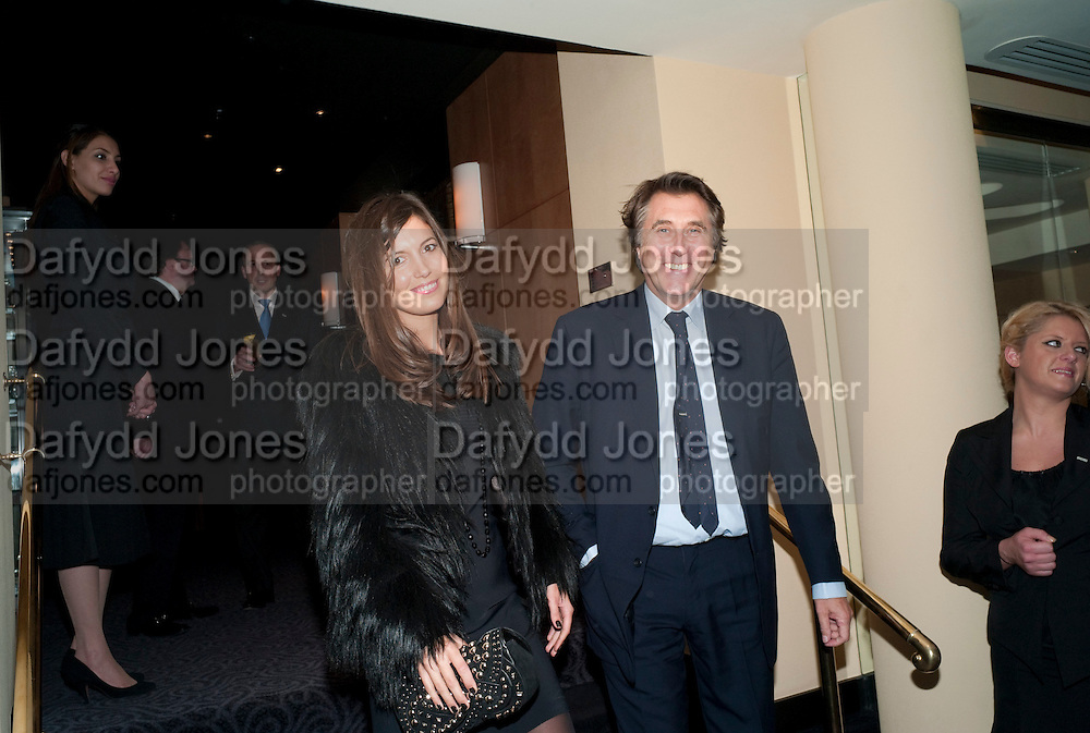 AMANDA SHEPPARD;BRYAN FERRY, Graydon Carter hosts a dinner to celebrate the reopening og the American Bar at the Savoy.  Savoy Hotel, Strand. London. 28 October 2010. -DO NOT ARCHIVE-© Copyright Photograph by Dafydd Jones. 248 Clapham Rd. London SW9 0PZ. Tel 0207 820 0771. www.dafjones.com.