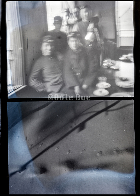 blurry picture of boys and a ship hull Japan ca 1940s