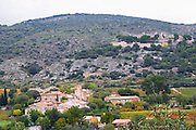 The old chateau Castellas and village of Montpeyroux. Montpeyroux. Languedoc. France. Europe.