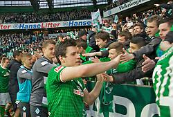 01.03.2014, Weserstadion, Bremen, GER, 1. FBL, SV Werder Bremen vs Hamburger SV, 23. Runde, im Bild Zlatko Junuzovic (Bremen #16) beim Abklatschen mit den Fans, der Ostkurve nach dem Abpfiff // Zlatko Junuzovic (Bremen #16) beim Abklatschen mit den Fans, der Ostkurve nach dem Abpfiff during the German Bundesliga 23th round match between SV Werder Bremen and Hamburger SV at the Weserstadion in Bremen, Germany on 2014/03/01. EXPA Pictures © 2014, PhotoCredit: EXPA/ Andreas Gumz<br /> <br /> *****ATTENTION - OUT of GER*****