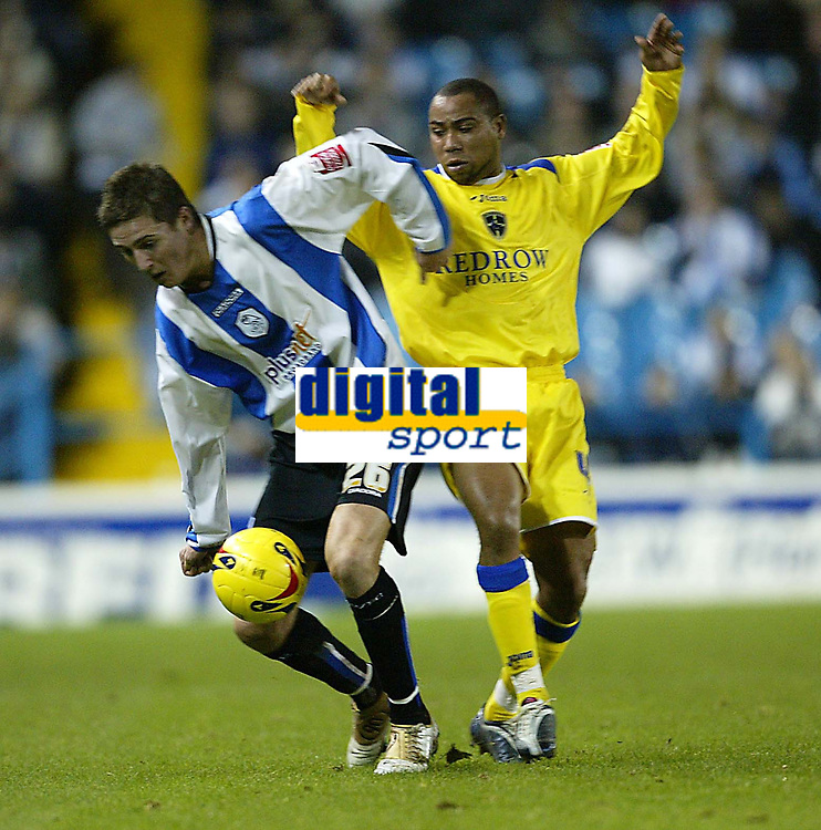 Photo: Aidan Ellis.<br /> Sheffield Wednesday v Cardiff City. Coca Cola Championship. 09/11/2005.<br /> Cardiff's Jeff Whitley bchallenges Sheffield's Barry Corr