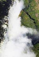 Zambezi river becomes Victoria Falls, or Mosi-oa-Tunya (Smoke that Thunders), between Zambia and Zimbabwe