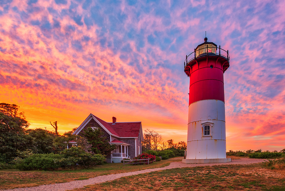 Cape Cod Chips Nauset Lighthouse on Cape Cod in Eastham, Massachusetts at sunset.