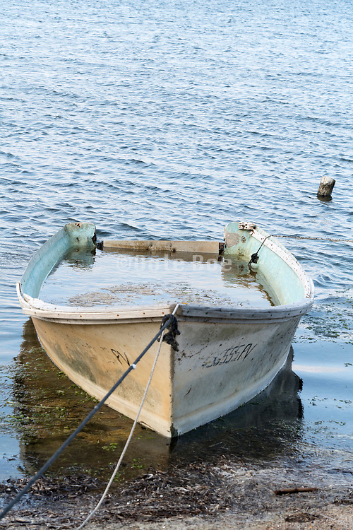 small boat filled with water