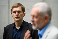 © Licensed to London News Pictures. 10/07/2016. London, UK. Director of Strategy SEUMAS MILNE watches Labour Party Leader JEREMY CORBYN as he speaks to media outside BBC Broadcasting House in London after appearing on the Andrew Marr Show, on July 10, 2016.  Photo credit: Ben Cawthra/LNP